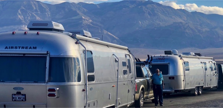Airstreams in front of mountains